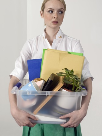 layoffs: Office Worker with Personal Belongings