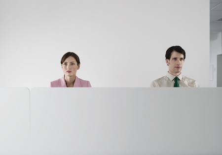 Office Workers Behind Cubicle Wall Stock Photo
