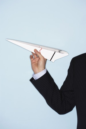 ennui: Businessman Throwing Paper Airplane