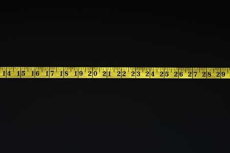 Inches on Measuring Tape Stock Photo - 5487791