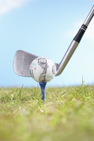 tee off: Teeing Off Golf Ball Covered in 100-Dollar Bill