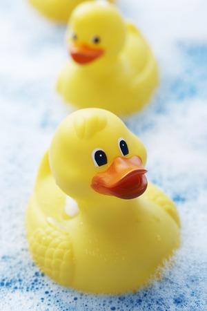 Row of Rubber Ducks in Bubble Bath Stock Photo - 5487803