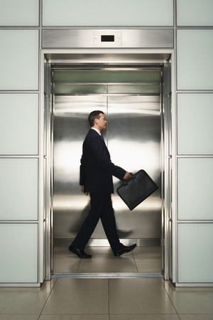 late 30s: Businessman in Elevator LANG_EVOIMAGES