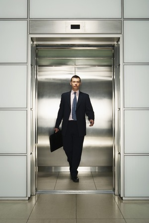 being the case: Businessman Exiting Elevator