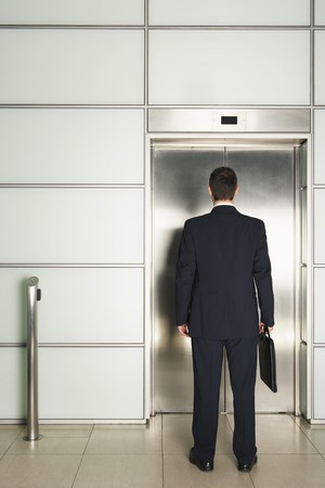 early thirties: Businessman Waiting for Elevator