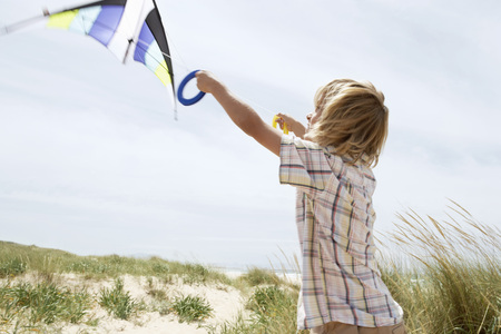 holidaying: Little Boy Flying a Kite