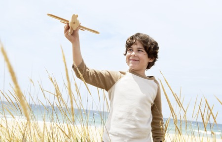 holidaying: Little Boy with a Toy Airplane LANG_EVOIMAGES