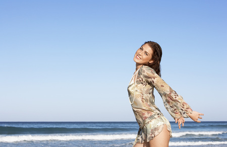 Smiling Young Woman at Ocean