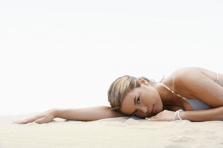 sex appeal: Pretty Young Woman Lying in Sand