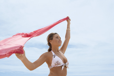 arms lifted up: Carefree Young Woman in Bikini
