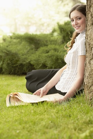 no kw 1: Woman Reading the Newspaper in the Grass