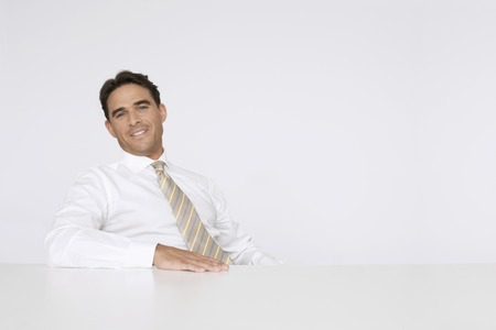 fortysomething: Businessman Sitting at Table LANG_EVOIMAGES