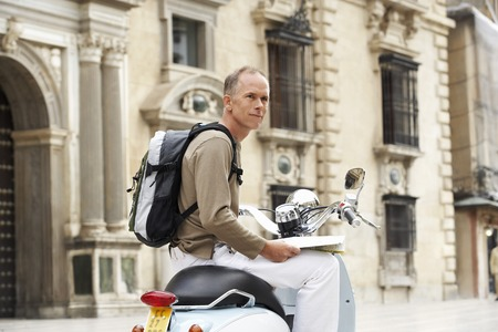 fortysomething: Tourist With Scooter in Square