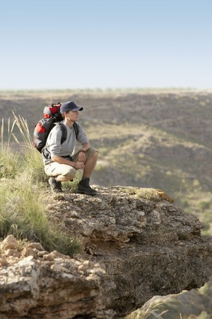 Hiker on Top of Mountain Range