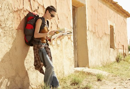 holidaying: Hiker Reading Map by Farmhouse