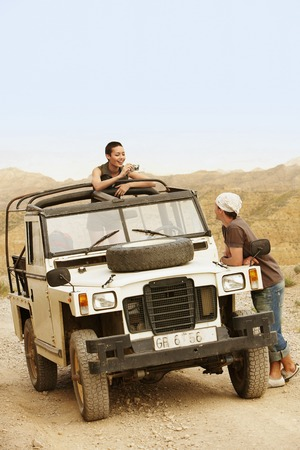 holidaying: Hikers in Land Rover