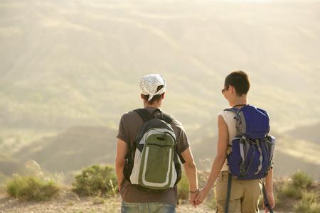 early twenties: Hikers Walking on Country Road