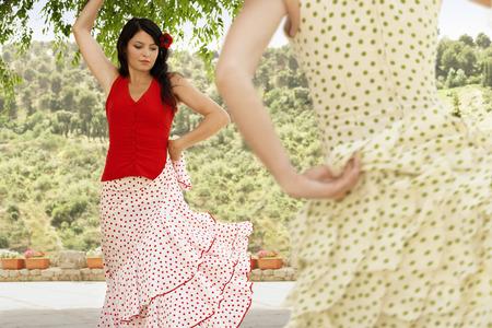 spaniards: Women Dancing in Flowing Dresses
