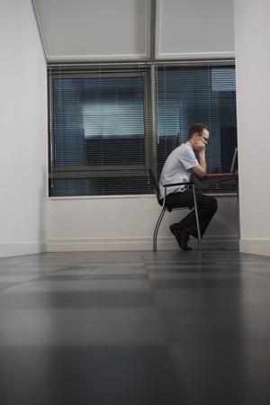 early twenties: Office Worker Using Computer