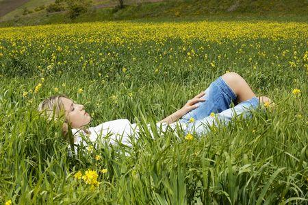 early twenties: Woman Lying in a Meadow
