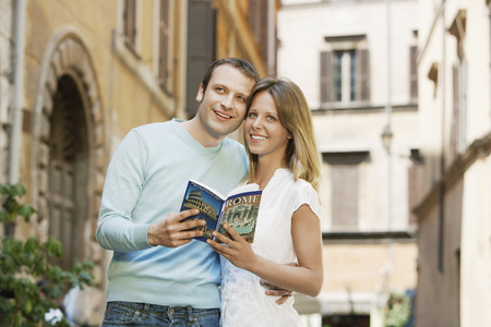 Happy Young Couple Sharing a  Guidebook
