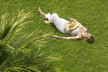 late 60s: Woman Lying in Grass