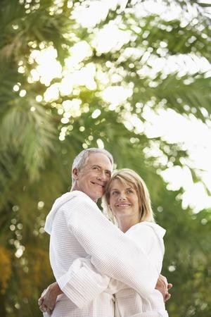 early sixties: Older Couple Hugging
