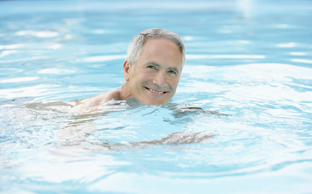early sixties: Older Man in Swimming Pool LANG_EVOIMAGES