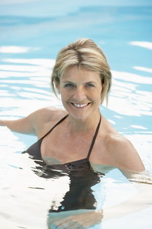 late 60s: Older Woman in Swimming Pool