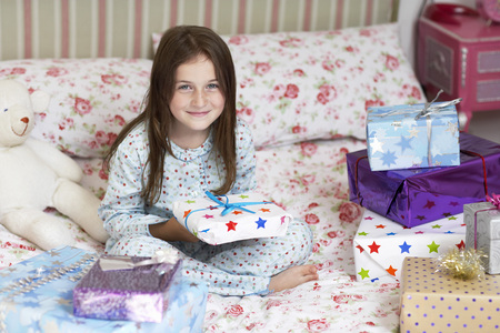 Smiling Girl with Many Presents Stock Photo
