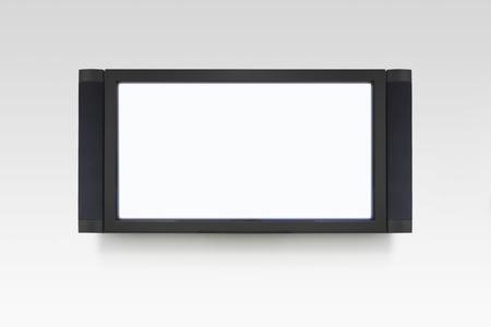 La televisión de pantalla plana en la pared blanca Foto de archivo