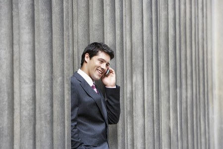 no kw 1: Businessman Talking on Cell  Phone LANG_EVOIMAGES