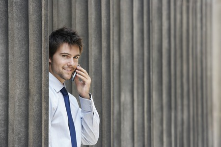 early twenties: Businessman Talking on Cell  Phone LANG_EVOIMAGES