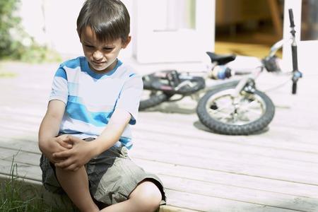 lonesomeness: Sad Little Boy Sitting on Deck