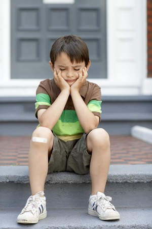 Little Boy Sitting on Steps Stock Photo