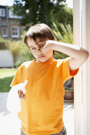 Little Boy Rubbing His Eyes Stock Photo