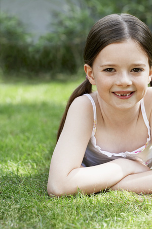 no kw 1: Little Girl Lying in Grass