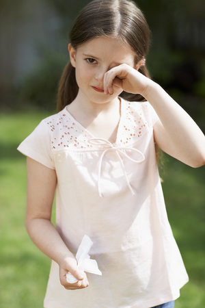Little Girl Rubbing Her Eyes Stock Photo