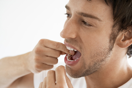 Man Flossing Teeth Stock Photo