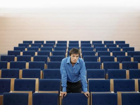 early twenties: Businessman in Auditorium