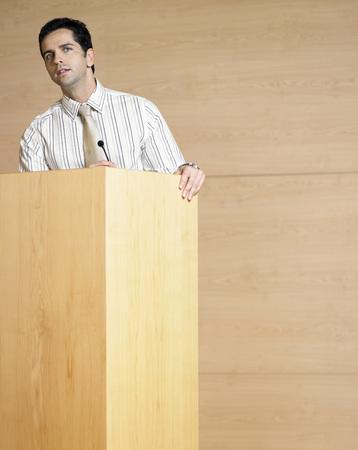 no kw 1: Businessman at Podium