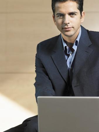 no kw 1: Businessman Using Laptop