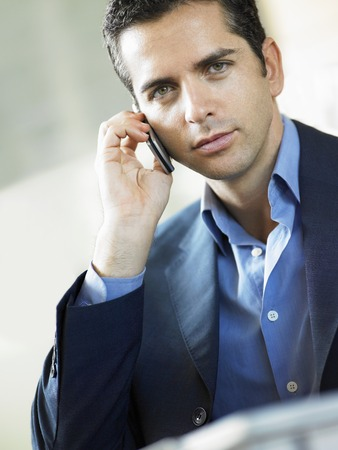 kw: Businessman Using Cell Phone