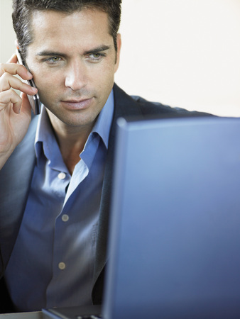 early thirties: Businessman Using Cell Phone and Laptop