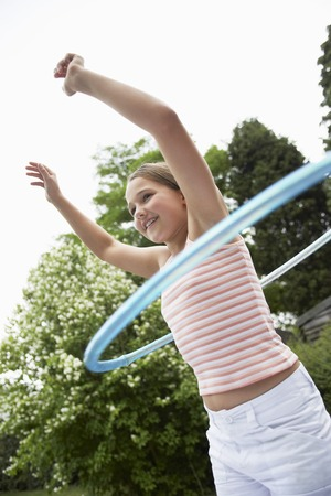 arms lifted up: Girl Playing with Hula Hoop