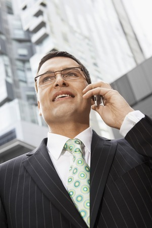 unspecified: Businessman Telephoning LANG_EVOIMAGES