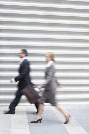action blur: Businesspeople Walking Fast