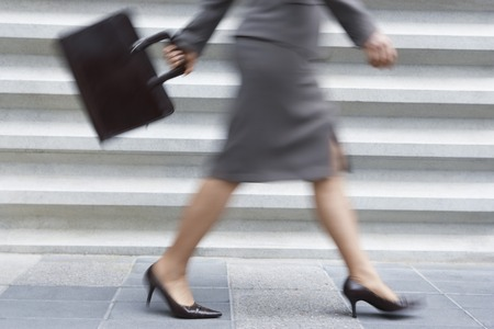 action blur: Businesswoman Walking Fast LANG_EVOIMAGES