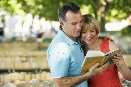 fortysomething: Couple Looking at Book LANG_EVOIMAGES