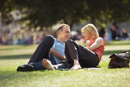 fortysomething: Couple Relaxing in Park
